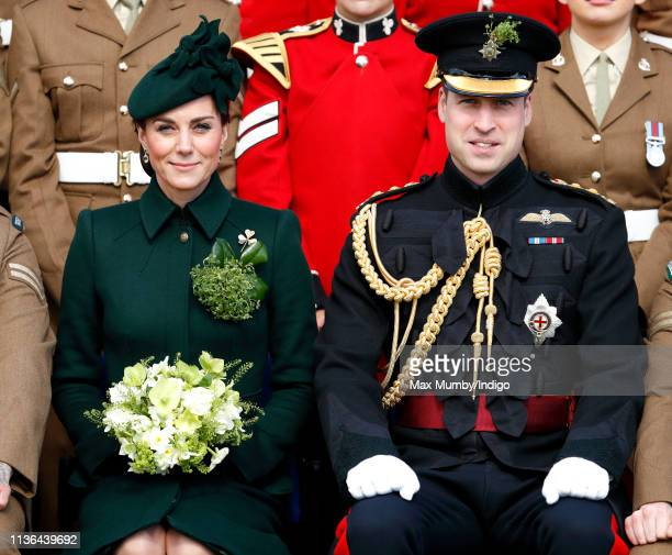 Catherine, Duchess of Cambridge and Prince William, Duke of Cambridge pose for a regiment photograph as they attend the 1st Battalion Irish Guards St...