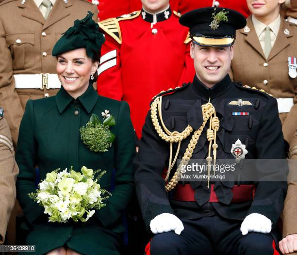 Catherine Duchess of Cambridge and Prince William Duke of Cambridge pose for a regiment photograph as they attend the 1st Battalion Irish Guards St...