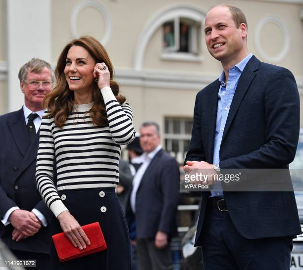 Catherine Duchess of Cambridge and Prince William Duke of Cambridge react as they look towards the Cutty Sark as they arrive to launch the King's Cup...