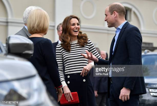 Catherine Duchess of Cambridge and Prince William Duke of Cambridge react as they arrive to launch the King's Cup Regatta at Cutty Sark Greenwich on...