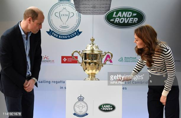 Catherine Duchess of Cambridge and Prince William Duke of Cambridge unveil the King's Cup trophy during the launch of the King's Cup Regatta at Cutty...