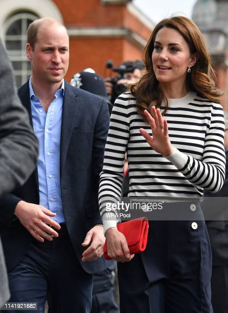 Catherine Duchess of Cambridge and Prince William Duke of Cambridge wave to wellwishers as they leave after attending the launch of the King's Cup...