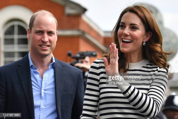 Catherine Duchess of Cambridge and Prince William Duke of Cambridge wave to well wishers as they leave after attending the launch of the King's Cup...