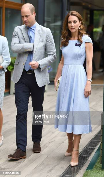 Catherine Duchess of Cambridge and Prince William Duke of Cambridge arrive the Men's Singles Final on day thirteen of the Wimbledon Championships at...