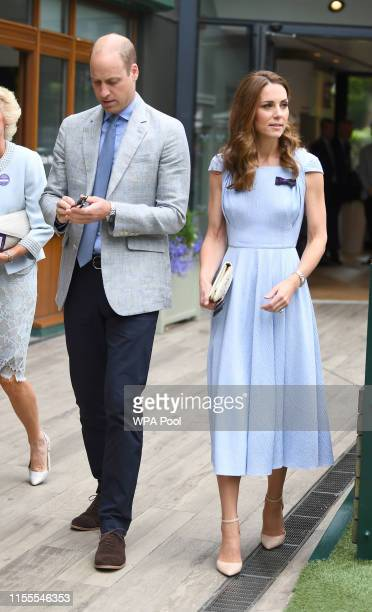 Catherine Duchess of Cambridge and Prince William Duke of Cambridge arrive ahead of the Men's Singles Final on day thirteen of the Wimbledon...
