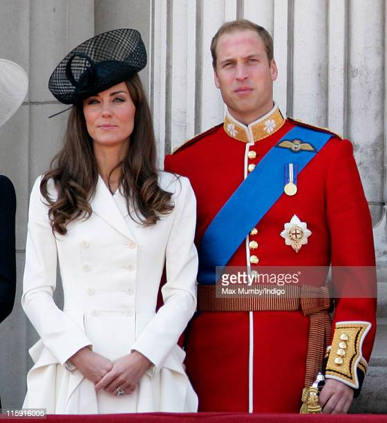 Catherine Duchess of Cambridge and Prince William Duke of Cambridge stand on the balcony of Buckingham Palace after the Trooping the Colour Parade on...
