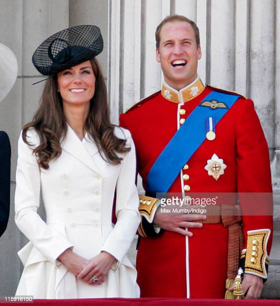 Catherine, Duchess of Cambridge and Prince William, Duke of Cambridge stand on the balcony of Buckingham Palace after the Trooping the Colour Parade...