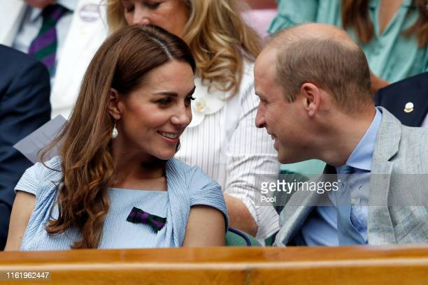 Catherine Duchess of Cambridge and Prince William Duke of Cambridge speak as they attend the Royal Box during the Men's Singles final between Novak...