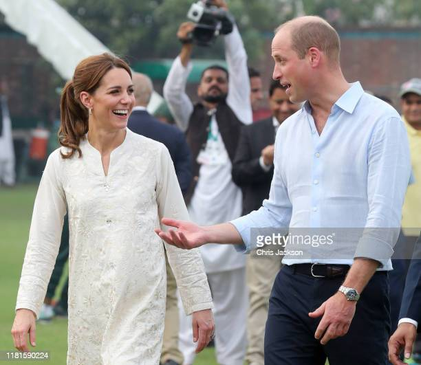 Catherine, Duchess of Cambridge and Prince William, Duke of Cambridge joke during their visit at the National Cricket Academy during day four of...