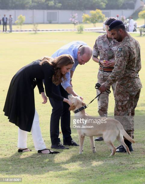 Catherine Duchess of Cambridge and Prince William Duke of Cambridge with golden labrador Polka as they visit an Army Canine Centre where the UK...