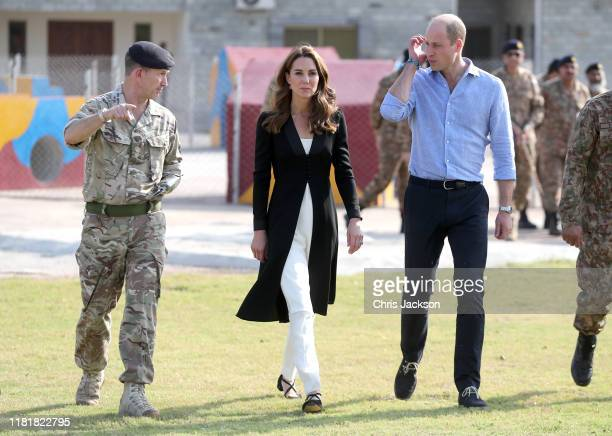 Catherine Duchess of Cambridge and Prince William Duke of Cambridge with British Army Lieutenant Colonel Colin Whitworth during a visit to an Army...