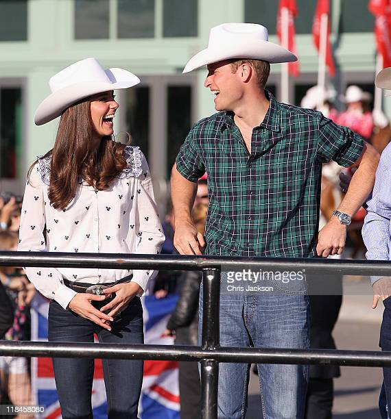Catherine Duchess of Cambridge and Prince William Duke of Cambridge watch a rodeo demonstration at a Government Reception at the BMO Centre on July 7...