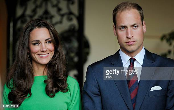 Catherine, Duchess of Cambridge and Prince William, Duke of Cambridge look on during a private reception at the British Consul-General's residence on...