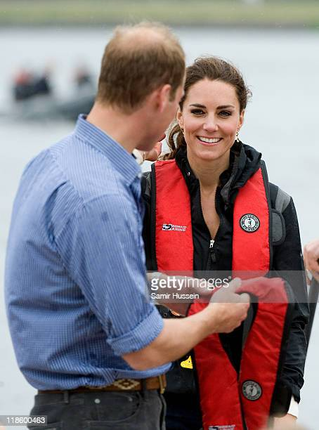 Catherine Duchess of Cambridge and Prince William Duke of Cambridge react after taking part in a dragon boat race at Dalvaybythesea on day 5 of the...