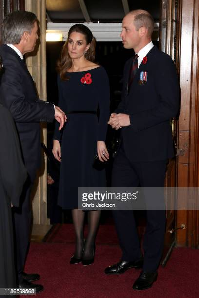 Catherine Duchess of Cambridge and Prince William Duke of Cambridge attend the annual Royal British Legion Festival of Remembrance at the Royal...