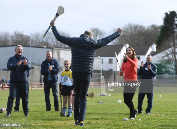 Catherine, Duchess of Cambridge and Prince William, Duke of Cambridge try their hand at Hurling as part of her visit to Salthill Knocknacarra GAA...