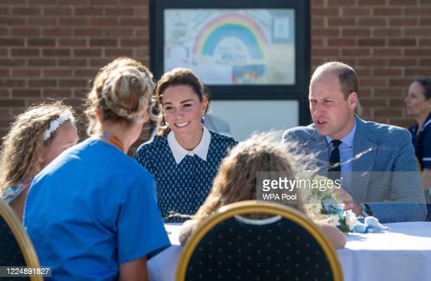 Catherine Duchess of Cambridge and Prince William Duke of Cambridge meet nurse Suzie Vaughan and daughters Hettie and Bella during their visit to...