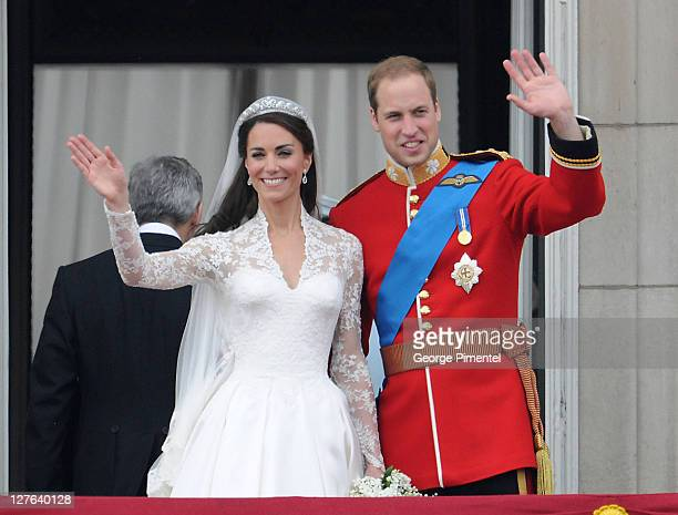 Catherine, Duchess of Cambridge and Prince William, Duke of Cambridge greet well-wishers from the balcony at Buckingham Palace on April 29, 2011 in...
