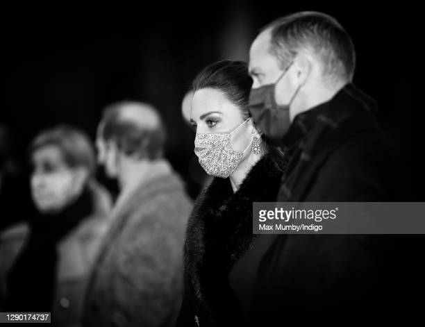 Catherine, Duchess of Cambridge and Prince William, Duke of Cambridge wear face masks as they attend an event to thank local volunteers and key...