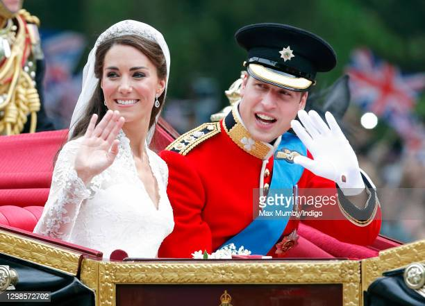 Catherine, Duchess of Cambridge and Prince William, Duke of Cambridge travel down The Mall, on route to Buckingham Palace, in the 1902 State Landau...