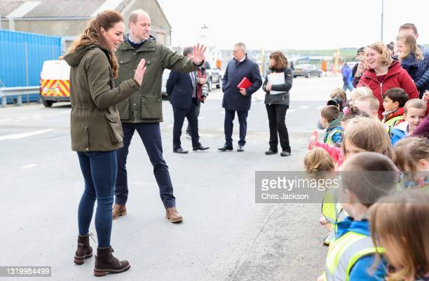 Catherine, Duchess of Cambridge and Prince William, Duke of Cambridge wave goodbye to school children as they visit the European Marine Energy Centre...