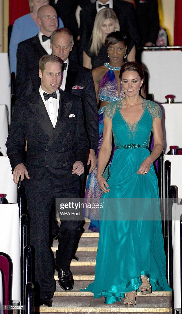 Catherine, Duchess of Cambridge and Prince William, Duke of Cambridge walk down the steps to the floor of the the Royal Albert Hall at 'Our Greatest Team Rises -BOA Olympic Concert' at the Royal Albert Hall on May 11, 2012 in London, England.
