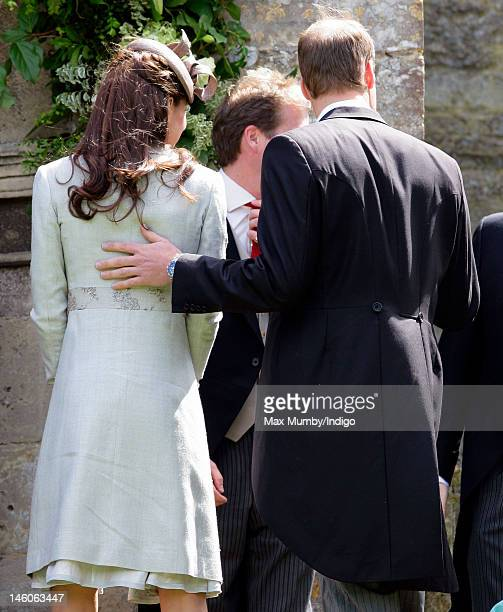 Catherine Duchess of Cambridge and Prince William Duke of Cambridge attend the wedding of Emily McCorquodale and James Hutt at The Church of St...