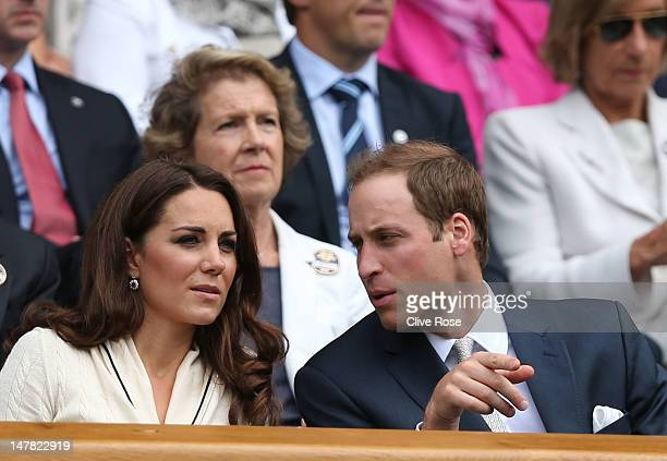 Catherine Duchess of Cambridge and Prince William Duke of Cambridge chat in the Royal Box on Centre Court during day nine of the Wimbledon Lawn...