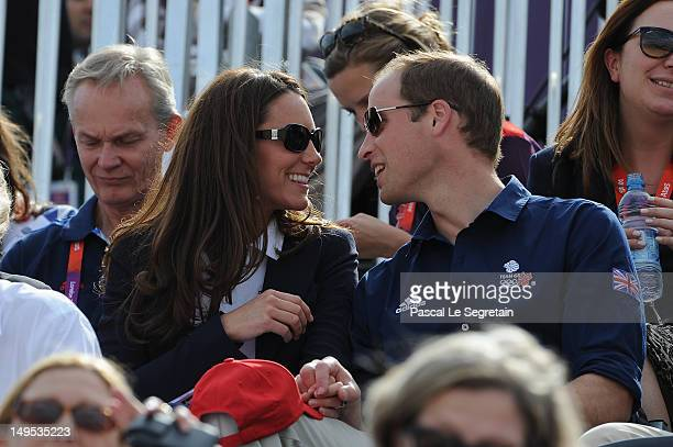 Catherine Duchess of Cambridge and Prince William Duke of Cambridge attend the Eventing Cross Country Equestrian event on Day 3 of the London 2012...