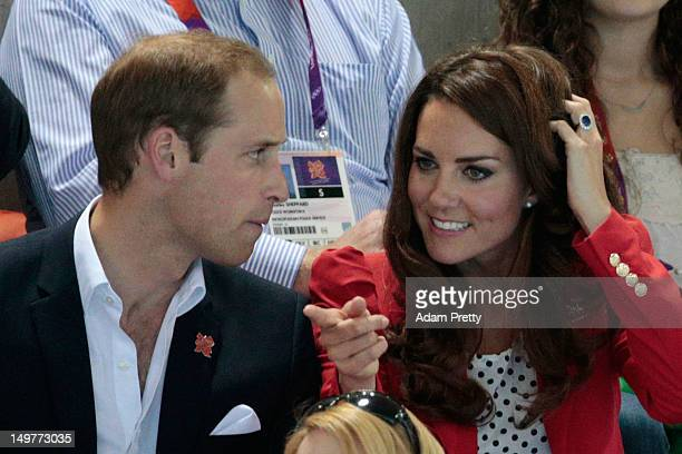Catherine Duchess of Cambridge and Prince William Duke of Cambridge watch the swimming finals session on Day 7 of the London 2012 Olympic Games at...