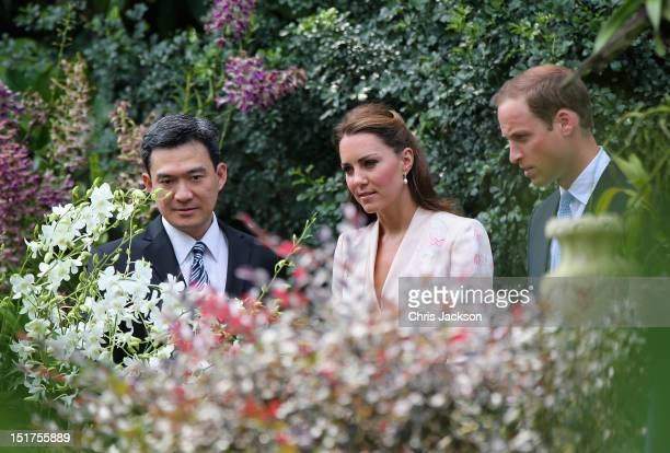 Catherine Duchess of Cambridge and Prince William Duke of Cambridge smile as they look at an orchid named in honour of Diana Princess of Wales at...