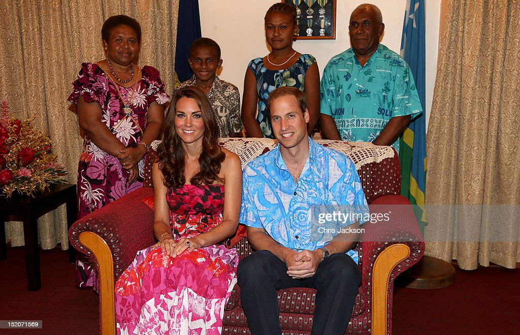 Catherine, Duchess of Cambridge and Prince William, Duke of Cambridge pose in traditional Island clothing with the Governor General Frank Kabui's family during a visit to his house on their Diamond Jubilee tour of the Far East on September 16, 2012 in Honiara, Guadalcanal Island. Prince William, Duke of Cambridge and Catherine, Duchess of Cambridge are on a Diamond Jubilee tour representing the Queen, taking in Singapore, Malaysia, the Solomon Islands and Tuvalu.
