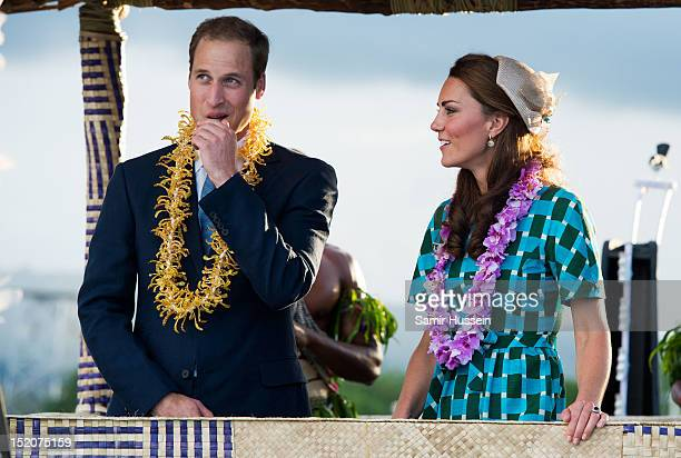 Catherine, Duchess of Cambridge and Prince William, Duke of Cambridge ride an open-top vehicle, shaped like a traditional canoe, at Honiara...