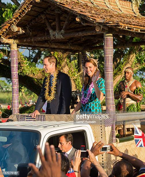 Catherine Duchess of Cambridge and Prince William Duke of Cambridge ride an opentop vehicle shaped like a traditional canoe at Honiara International...