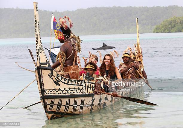 Catherine, Duchess of Cambridge and Prince William, Duke of Cambridge travel in a traditional canoe during a visit to Tuvanipupu Island on their...