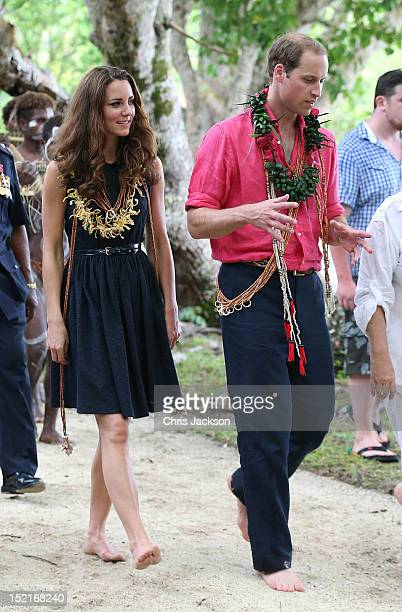 Catherine Duchess of Cambridge and Prince William Duke of Cambridge are greeted by dancers as they visit Tuvanipupu Island on their Diamond Jubilee...