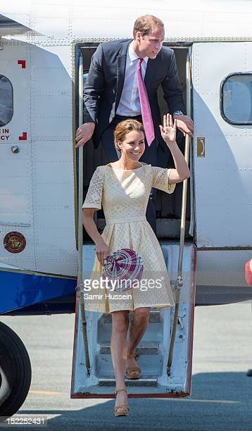 Catherine, Duchess of Cambridge and Prince William, Duke of Cambridge exits a plane to join a departure ceremony at Honiara Airport during the Royal...
