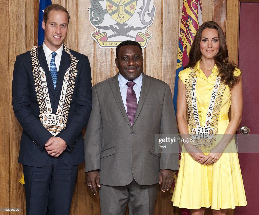 Catherine, Duchess of Cambridge and Prince William, Duke of Cambridge are seen wearing personalised necklaces given to them as they visit the Prime Minister of the Solomon Islands Gordon Darcy Lilo (C) and the cabinet on day 7 of their Diamond Jubilee Tour, on September 17, 2012 in Honiara, Solomon Islands. Prince William, Duke of Cambridge and Catherine, Duchess of Cambridge arrived in the Solomon Islands as the first stop of the Pacific leg of their nine day Diamond Jubilee Tour of the Far East and South Pacific.