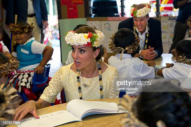 Catherine, Duchess of Cambridge and Prince William, Duke of Cambridge meet children at Nauti Primary School during the Royal couple's Diamond Jubilee...