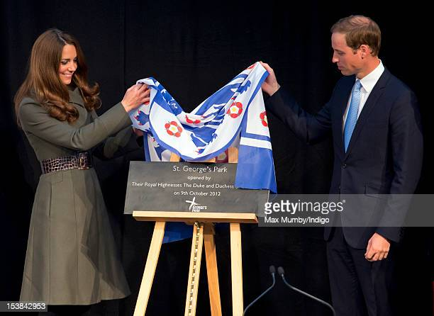 Catherine Duchess of Cambridge and Prince William Duke of Cambridge unveil a plaque as they attend the official launch of The Football Association's...