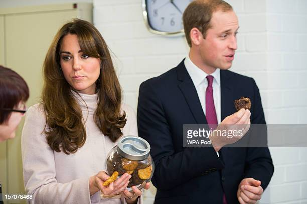 Catherine Duchess of Cambridge and Prince William Duke of Cambridge try cookies as they visit 'Jimmy's' a night shelter on November 28 2012 in...