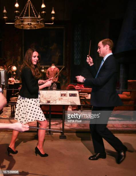 Catherine Duchess of Cambridge and Prince William Duke of Cambridge pretend to challenge each other with their wands during the Inauguration Of...