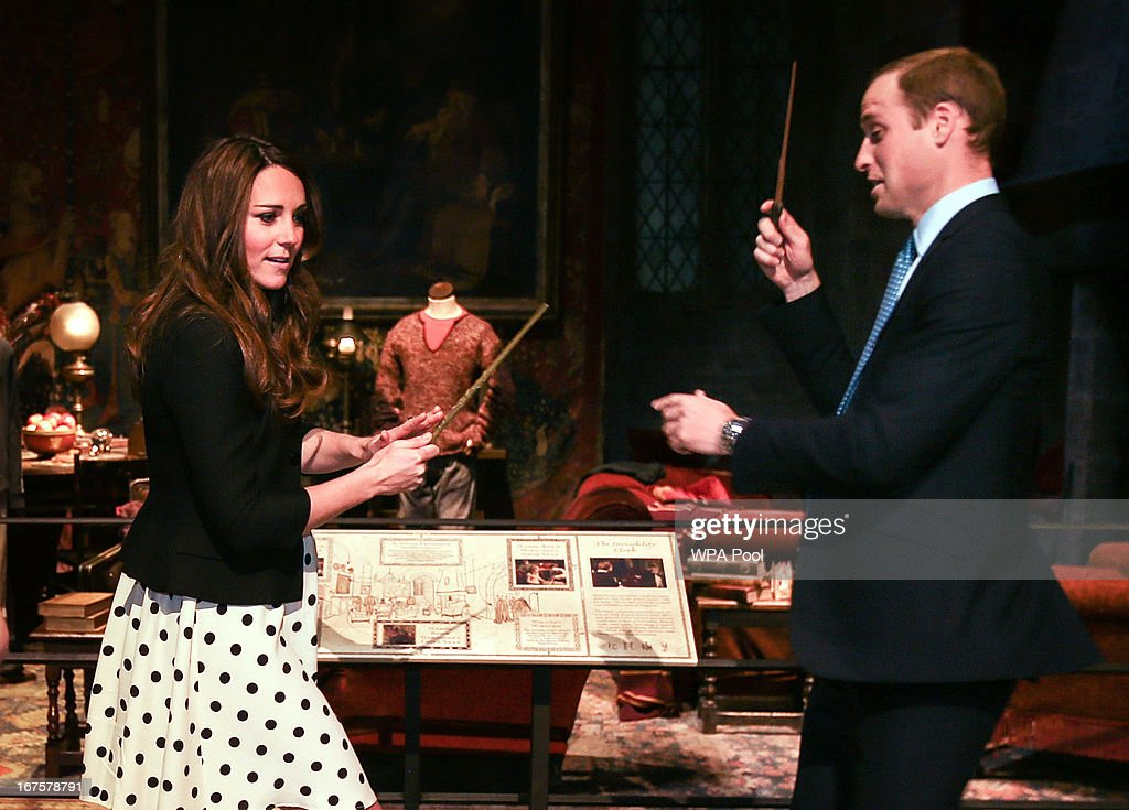Catherine, Duchess of Cambridge and Prince William, Duke of Cambridge pretend to challenge each other with their wands during the Inauguration Of Warner Bros. Studios Leavesden on April 26, 2013 in London, England.
