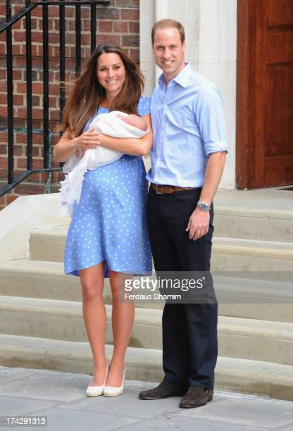 Catherine Duchess of Cambridge and Prince William Duke of Cambridge depart The Lindo Wing with their newborn son at St Mary's Hospital on July 23...