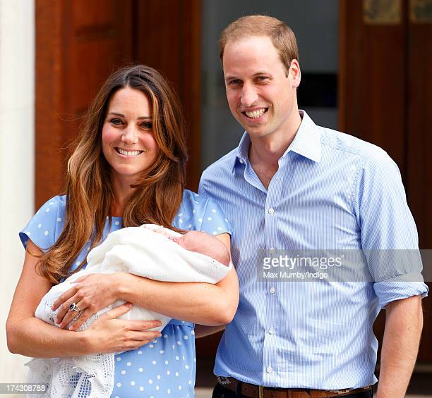 Catherine Duchess of Cambridge and Prince William Duke of Cambridge leave The Lindo Wing with their newborn son at St Mary's Hospital on July 23 2013...