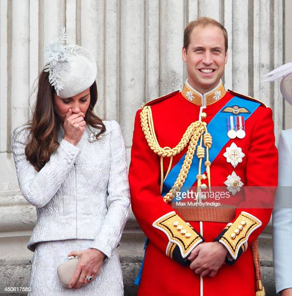 Catherine, Duchess of Cambridge and Prince William, Duke of Cambridge watch the fly-past from the balcony of Buckingham Palace during Trooping the...