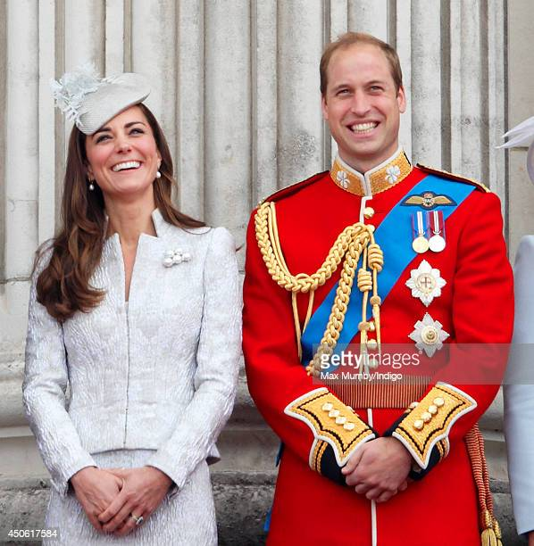 Catherine Duchess of Cambridge and Prince William Duke of Cambridge watch the flypast from the balcony of Buckingham Palace during Trooping the...