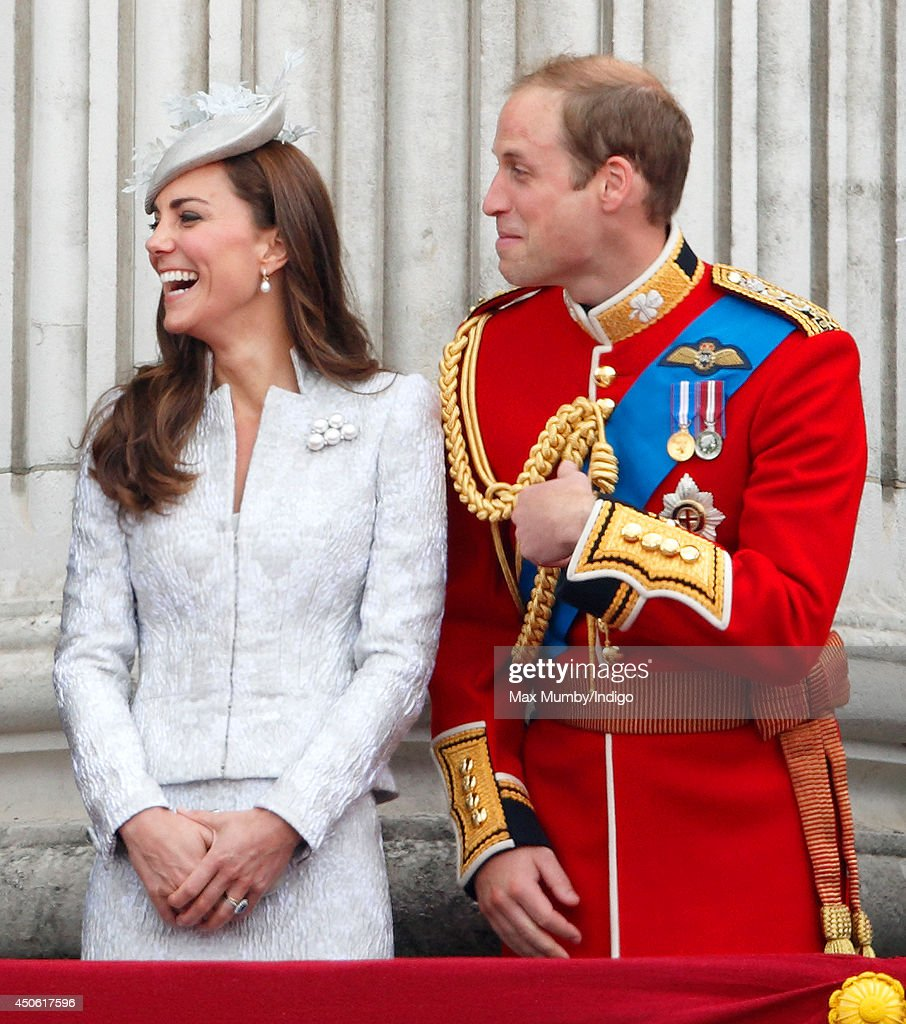 Catherine, Duchess of Cambridge and Prince William, Duke of Cambridge watch the fly-past from the balcony of Buckingham Palace during Trooping the Colour, Queen Elizabeth II's Birthday Parade on June 14, 2014 in London, England.