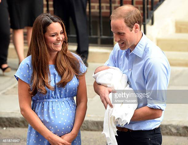 Catherine Duchess of Cambridge and Prince William Duke of Cambridge who is holding their newborn son depart the Lindo Wing of St Mary's Hospital on...
