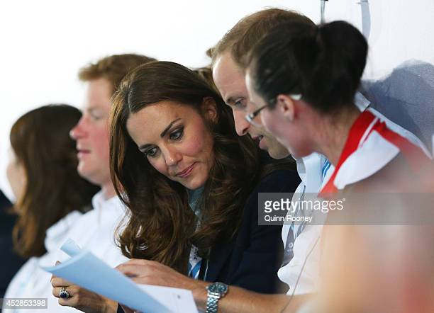 Catherine Duchess of Cambridge and Prince William Duke of Cambridge attend the evening session at Tollcross International Swimming Centre during day...